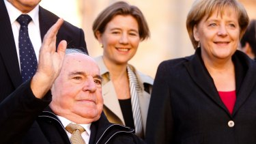 Former German Chancellor Helmut Kohl and current German leader Angela Merkel mark the 20th anniversary of Germany's reunification in Berlin in 2010.