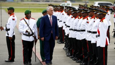 Prime Minister Malcolm Turnbull inspects the military guard as he departs Papua New Guinea for India.