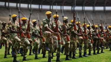 Zimbabwean soldiers prepare for Friday's presidential inauguration of Emmerson Mnangagwa, at the National Sports Stadium in Harare, Zimbabwe.
