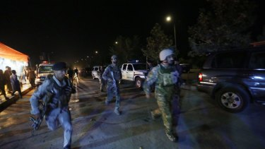 Afghan security forces rush to respond to the attack on the university.