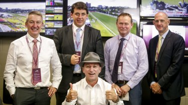 Retiring jockey Jim Cassidy (seated) with stewards (from left) Rob Montgomery, Terry Bailey, Robert Cram and Kim Kelly at Flemington in November 2015.