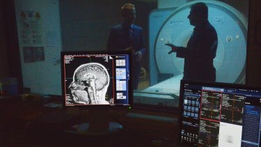 Research scientists Pascal Molenberghs, left, and Juan Dominguez, right, analysed MRI scan results  showing the effects of disagreement on people's brains.