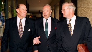 Kerry Packer (left), Bruce Gyngell (centre) and Brian Powers (right) leave the Publishing and Broadcasting Limited annual general meeting in 1996.