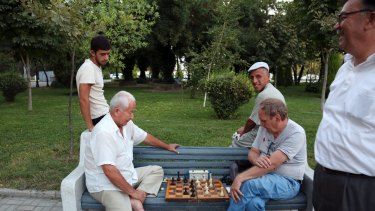 People play chess in a park in Tashkent, Uzbekistan on Tuesday.