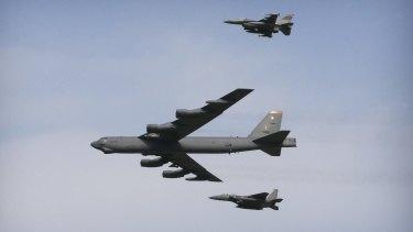 A US Air Force B-52 bomber flies over Osan Air Base in Pyeongtaek, South Korea, on Sunday.