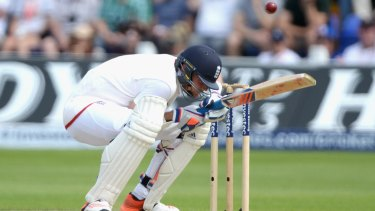 Stuart Broad of England ducks a short ball from Mitchell Johnson.
