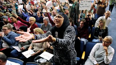 Noor Ul-Hasan reacts during Republican Jason Chaffetz's town hall meeting in Cottonwood Heights, Utah. Utah refugee officials and Muslim advocates said the revised travel ban doesn't alleviate their concerns about an initiative they contend unfairly targets refugees and Muslim countries.