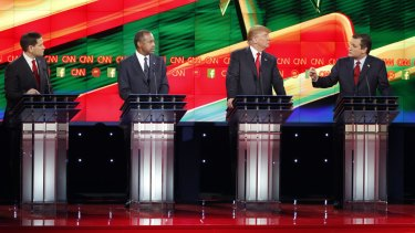 Ted Cruz, right, speaks during an exchange with Marco Rubio, left, as Ben Carson, second from left, and Donald Trump look on.