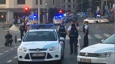 In this image taken from video, police cars block a road near the train station in central Brussels on Tuesday.