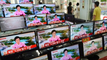 TV screens at a Yongsan Electronic shop showing a news bulletin about the North Korean missile test.