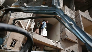 Yemeni people inspect a house damaged by a Saudi air strike in Sanaa, Yemen, last August.