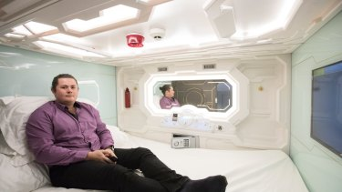 Manager James Oliver inside a pod in Sydney's first capsule hotel.