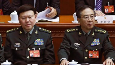 Zhang Yang, left, then head of the People's Liberation Army political affairs department, and Fang Fenghui, then chief of the general staff of the PLA in March.