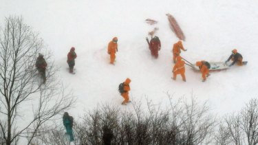 Firefighters make rescue operation at a ski resort following an avalanche in Nasu.