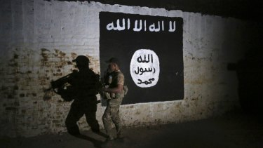 An Iraqi soldier inspects a train tunnel that was turned into a training camp for IS fighters.