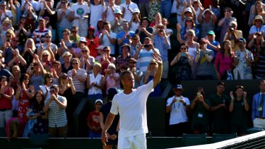 Fond farewell: Australia's Lleyton Hewitt waves goodbye to the Wimbledon crowd after losing to Jarkko Nieminen.