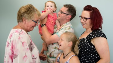 Eunice Lee (left), with her son, Mark Lee, who has successfully completed a gene therapy trial for haemophilia, and her granddaughters, Grace, 10, and Violet ,18 months, and her daughter-in-law, Shannon Salo, at the Charles Perkins Centre at RPA in Sydney.