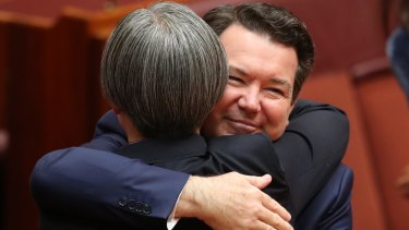 Senator Penny Wong is hugged by co-sponsor Senator Dean Smith earlier this month.