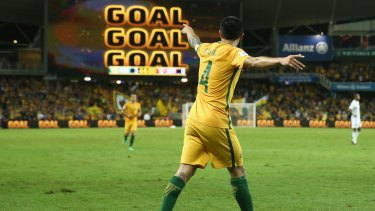 Sign says it all: Tim Cahill celebrates scoring another goal for the Socceroos.