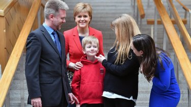 Gregg, Kathryn and Lachlan Brain meet Scotland's First Minister Nicola Sturgeon, second from left, and MP Kate Forbes, right, at the Scottish Parliament in May.
