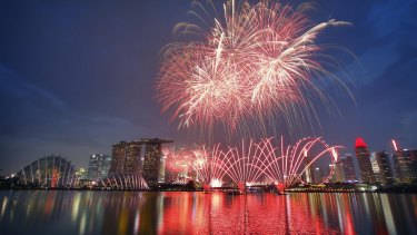 Fireworks explode above Singapore's financial district as part of celebrations to mark the nation's 50th year of independence.