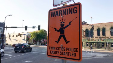 "A fake street sign in Minneapolis warns of  ""easily startled"" police officers."