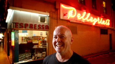 Filmmaker Lawrence Johnston takes in the neon glow at Melbourne espresso bar Pelligrini's.