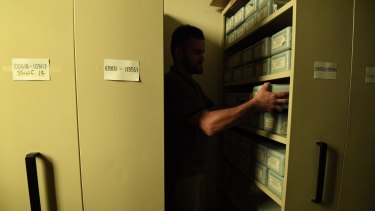 This room fitted with sliding filing cabinets, similar to those used in doctors' and lawyers' offices, contains around 800 boxes of cremated human remains that have not been collected by families.