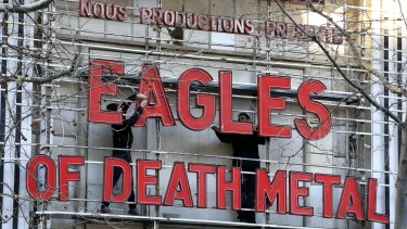 Workers set up a sign before Tuesday's concert by Eagles of Death Metal. Survivors of November's deadly attacks have opened up to a French terrorism commission before the highly charged concert.
