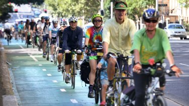Cyclists take to the green cycle paths on College Street in Sydney's CBD to defend their use and practicality
