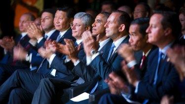 The G20 line-up applauds.