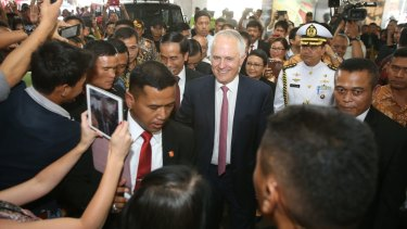 Prime Minister Malcolm Turnbull with Indonesian president Joko Widodo in Jakarta during a stroll through a local textile market.