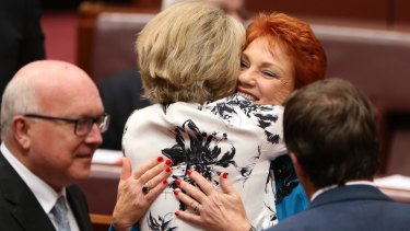 In happier times: Senator Michaelia Cash hugged Senator Pauline Hanson after her first speech in the Senate on Wednesday.