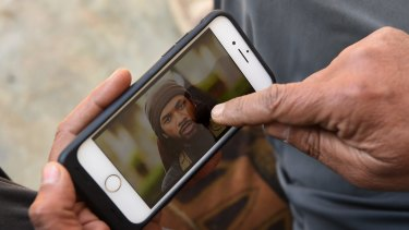 Yusuf Abbas, 51, points to a photo of Neil Prakash identifying him as the foreign fighter he saw in Mosul.