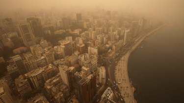 An unseasonal sandstorm shrouds Beirut, Lebanon, on Tuesday.