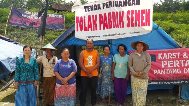 """Tegaldowo villagers at their tent vigil. The big sign reads: """"Struggle Tent. Reject the cement factory."""""""