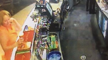 CCTV still shows Sharon Yarnton, far left in orange shirt, buying a beer at the Merrylands Bowling Club on January 31, 2015