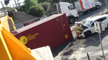 The container stuck under the bridge