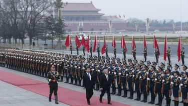 Chinese President Xi Jinping (left) accompanies German President Joachim Gauck to view an honour guard during a welcoming ceremony in the Great Hall of the People in Beijing on Monday.