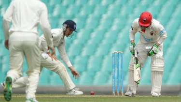 Hughes staggers after being struck.