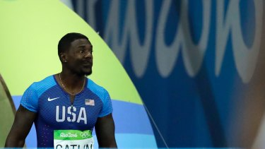 United States' Justin Gatlin makes a face as he is booed when entering the stadium for the men's 100m final in Rio on Sunday.