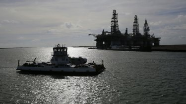 Oil platforms are ferried away from Port Aransas, Texas, after a mandatory evacuation was ordered in preparation for Hurricane Harvey.