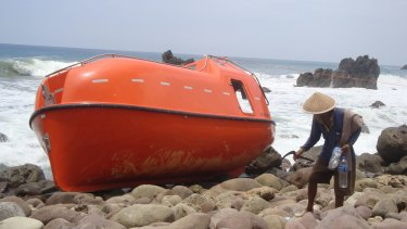 A lifeboat stranded on  Karangjambe beach in Kebumen, Indonesia, after asylum seekers were towed back by Australian authorities en route to Christmas Island.