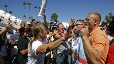 More of this to come? Trump supporters and protesters clash as Trump speaks in Fountain Hills, Arizona.