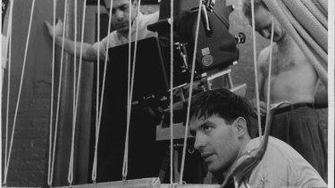 John Cassavetes directing a scene for his film Shadows.