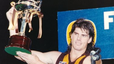 Another trophy: Yep, a Hawthorn premiership ... Gary Ayres with the 1992 Foster's Cup.