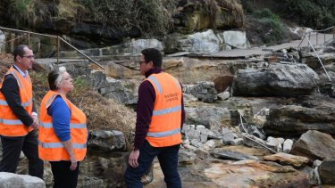 Waverley Council Mayor Sally Betts with engineers examine the Bondi coastal walk on Friday ahead of another potential storm event.