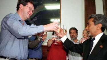 Australia's then foreign minister Alexander Downer and Mari Alkatiri, at the time East Timor's cabinet member for economic affairs and now the prime minister, pictured in 2001 after signing an agreement to share oil and natural gas revenues from drilling in the Timor Sea.