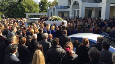 Masa's coffin leaves the funeral service in Springvale.