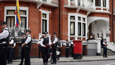 Police standing guard outside the Ecuadorian embassy in 2012.